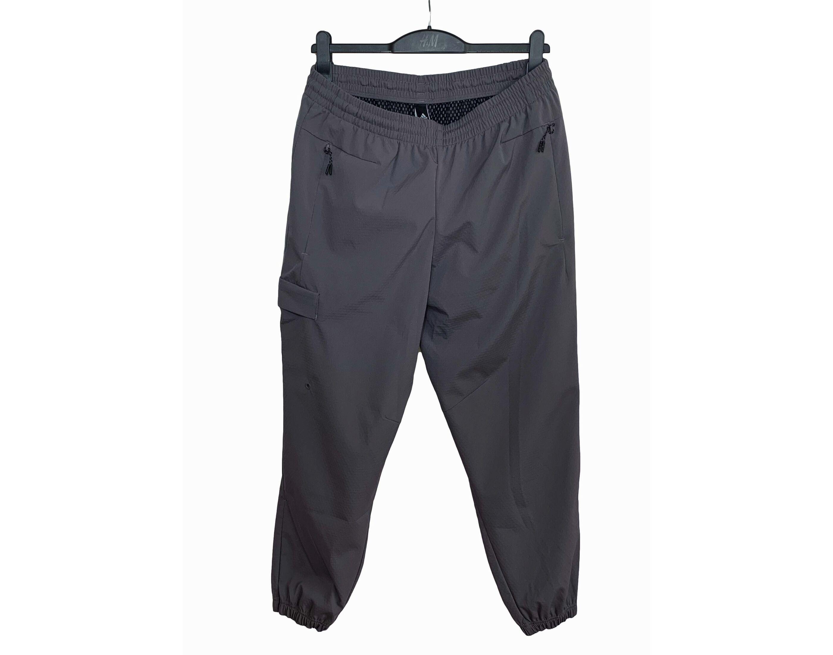 Adidas bemelegítő nadrág (M)